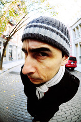 whatchu lookin at? (the half-blood prince) Tags: hat scarf seth soho fisheye cobblestones eyebrow doublecappuccino nikkor105mmf28fisheye