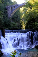 Iglica Waterfall (Kalexander2010) Tags: bridge cliff motion colour tree water forest river landscape outdoors photography waterfall energy day nopeople h2o slovenia limestone bled liquid idyllic scenics tranquilscene travelphotography traveldestinations beautyinnature physicalgeography kalexander iglicawaterfall suhastream kalexanderphotography klalexanderphotography