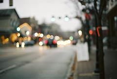 city alight II (jamie {74}) Tags: street 35mm nikon bokeh streetlamps f100 headlights nikkor oof kodakportra160nc hbw sooc bokehlights bokehwednesday blartsy nikkor50mmf14g