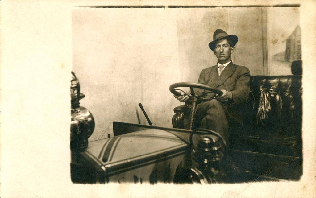 Man Behind the Wheel.  Novelty RPPC.