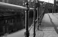 waterfront (Gabo Barreto) Tags: uk 2 bw film water river dof waterfront yorkshire grain leeds rangefinder 135 banister fed aire 61 gabo industar barreto gabobarreto