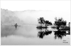 Water everywhere, nor any drop to drink.. (andzer) Tags: morning autumn sea bw mist reflection tree water fog boat fishing vessel az andreas scape 2010 myfaves chalkidiki zervas andzer