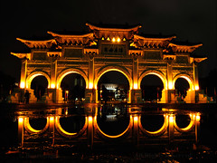 TAIPEI (BoazImages) Tags: light urban reflection history rain modern night puddle photography gold mirror golden colorful asia chinese taiwan atmosphere flare romantic taipei  fareast  flares memorialhall  chiangkaishek traveldestinations  republicofchina boazimages