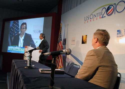 Agriculture Secretary Tom Vilsack watches the Honorable Carlos Pascual, United States Ambassador to Mexico speaking at the United Nations Climate Change Conference in Cancun, Mexico on Thursday, December 9, 2010.