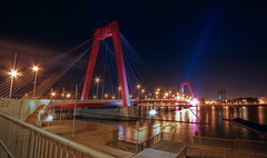 Willemsbrug Rotterdam (DolliaSH) Tags: city longexposure trip travel bridge light vacation urban holiday haven holland color tourism water colors architecture night canon reflections river puente photography lights noche photo rotterdam topf50 europe foto fotografie tour place nightshot photos nacht harbour nederland thenetherlands visit location tourist ponte most le journey pont destination wired traveling brug avond maas visiting brcke topf100 nuit notte touring stad willemsbrug noch zuidholland brucke canonefs1022mmf3545usm southholland nachtopname manhattanaandemaas canoneos50d dollia dollias sheombar dolliash