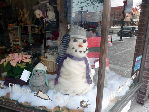 roving snowman in the yarn shop window