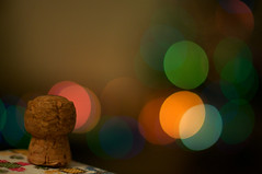Merry Christmas! (Porfidax) Tags: christmas light 50mm bottle nikon bokeh cap merry bubbly d90 bokehhearts