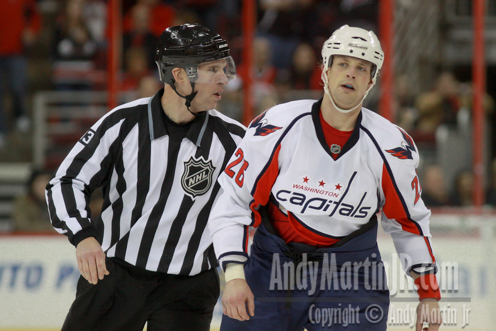 Washington Capitals Matt Hendricks #26 is escorted off the ice by Linesman Brian Murphy #93 after recieving a two minute roughing penalty at 18:54 in the first period.  The Washington Capitals defeate