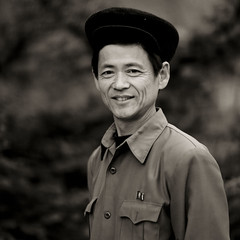 North Korean man - North Korea (Eric Lafforgue) Tags: people blackandwhite man male smile vertical person war asia noiretblanc joy happiness korea communism asie coree sourire bonheur personne humanbeing joie communisme homme northkorea dprk coreadelnorte lookingatcamera nordkorea blackandwhitepicture waistup 7080 democraticpeoplesrepublicofkorea    coreadelnord  etrehumain coreedunord  insidenorthkorea  rpdc  regardantlobjectif kimjongun coreiadonorte  republiquepopulairedemocratiquedecoree cadragealataille