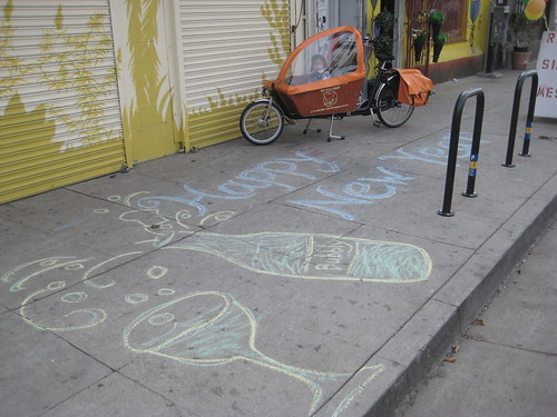 Happy New Year sidewalk chalk in front of Flying Pigeon LA