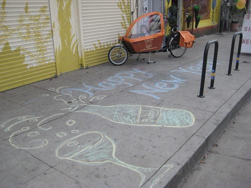 Happy New Year sidewalk chalk in front of Flying Pigeon LA