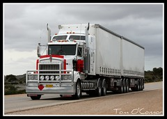 T950 (Tom O'Connor.) Tags: road sky cloud west rain train truck canon lens eos long hole under twin down blow perth land vehicle trucks kit straight past bound 90 mile trucking roadhouse 2010 nullarbor truckers kenworth caiguna bdouble t950 1000d