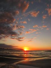 Sunset, Ocean Beach (blue polaris) Tags: ocean sunset sea newzealand cloud seascape west reflection beach landscape coast sand scenery nz waikato northisland tasman kawhia