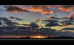 sunset in kubaard (Wim Koopman) Tags: sunset sky sun holland netherlands dutch clouds canon photography photo colorful stock powershot friesland fryslan stockphoto s90 kleurrijk stockphotography s100 kubaard wpk s95