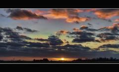 sunset in kubaard (Wim Koopman) Tags: sunset sky sun holland netherlands dutch clouds canon photography photo colorful stock powershot friesland fryslan stockphoto s90 kleurrijk stockphotography s100 kubaard wpk s95