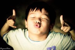 I give u a kiss (DiyanaChan) Tags: boys kids bokeh potrait