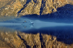 Ghostly Cruise Ship (Atilla2008) Tags: sunrise nikon ship calm serene ghostly montenegro kotor mirroreffect d90 bayofkotor mygearandmepremium mygearandmebronze mygearandmesilver mygearandmegold mygearandmeplatinum