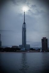 the hugest candle in Kyushu (kohki) Tags: city sea sun tower beach sigma snap fukuoka kyushu foveon   momochi  dp2s