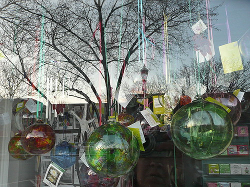 Glass globes with shop window reflections