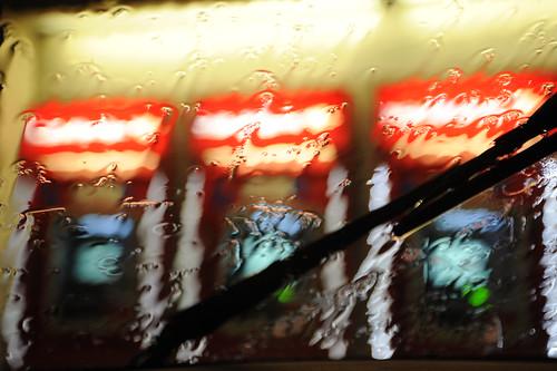 Bank of America cash machines in a row, windshield wiper, rain, University Village, Seattle, Washington, USA by Wonderlane