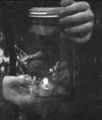 202/365 (Carley Merriman) Tags: blackandwhite hands grain jar glassjar