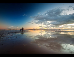 Togs vs Clouds II, Frantic on Crosby beach. Explore (Ianmoran1970) Tags: sky cloud colour beach wet docks reflections landscape sand photographer boots ripple photographers cranes crosby seaforth muddyboots explored ianmoran redmatrix ianmoran1970 downtotwobynow
