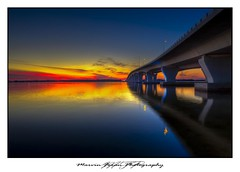 Hathaway Bridge Sunset (Marvin Foran Photography) Tags: longexposure sunset reflection water florida bridges dramatic hdr panamacitybeach panamacityfl hathawaybridge northwestfloridariversandstreams baycofl