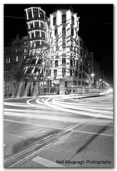 Dancing House Prague @ night (Neil Kavanagh) Tags: street bw downtown traffic tram wideangle praha nighttime canon5d lighttrails frankgehry dancinghouse novmesto tancdm drunkhouse downtownprague canon1740mmlseries domiluni