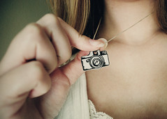 Vintage Camera Necklace (SOMETHiNG MONUMENTAL) Tags: camera vintage necklace nikon handmade fingers jewelry charm retro plastic shrinkplastic whiteandblack d60 somethingmonumental mandycrandell