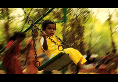 Swinging with joy (VinothChandar) Tags: india color colour green colors yellow canon children happy photography photo colorful colours child photos bokeh pics madras joy happiness swing photograph delight enjoy 5d colourful joyful bliss chennai enjoyment pleasure tamilnadu joyfulness vandalur