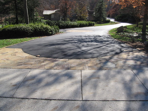 recent picture of flagstone laid into driveway and stone curbing in Raleigh, North Carolina