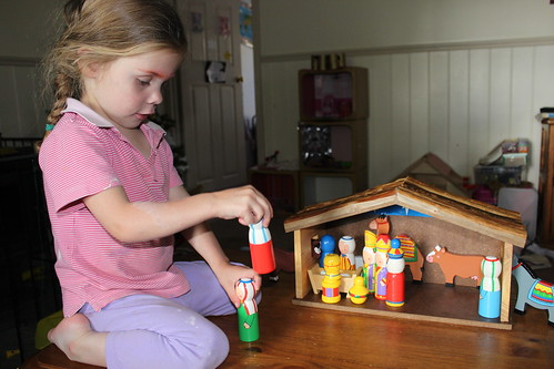 Amelia playing with the Nativity set