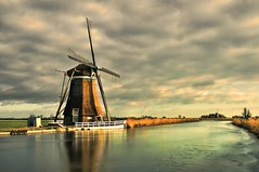 dutch windmill 5 (Wim Koopman) Tags: light holland reflection mill reed water netherlands windmill clouds river photography canal photo nikon afternoon ditch wind stock late stockphoto stockphotography d90 wpk grootammers