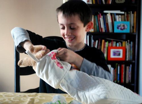 Nick Stuffing Madeline's Stocking
