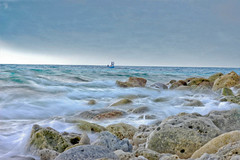 ~♥*~''Waves breaking over rocks as a foggy...♥¨`» (RíchÝ) Tags: blue sea sky cloud blur beautiful beauty rock clouds island idea waves cloudy background awesome feel smooth bluewater foggy awsome colourful maldives breaking impressedbeauty