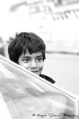 Eyes of innocence ! (Mayank Sharma renewed :D :D) Tags: street portrait bw india car canon kid eyes sweet delhi streetphotography innocence chandnichowk canon50mm