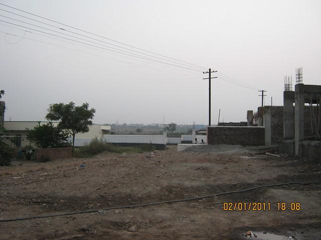 Proposed D P road to Mercedes - Bosch Plants at Chakan - Spacious 1 BHK Flat for 11 Lakhs at Nanekarwadi Chakan Pune 410510