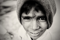 Portrait of an innocent child (Sayid Budhi) Tags: portrait people bw india children fatehpursikri human bwblackandwhite northindia uttarpradesh childrenportrait incredibleindia photographictour humaninterestphotography travelasiaphotographycom culturalandhumanitarianphotojournalist