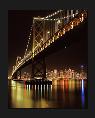Dark Place, Bright View (RZ68) Tags: sanfrancisco christmas city bridge light sky holiday reflection water skyline night buildings reflections lights bay san francisco long exposure treasureisland pyramid under line velvia baybridge 6x7 transamerica beacon provia yerbabuenaisland e100 flickrsbest daarklands rz68