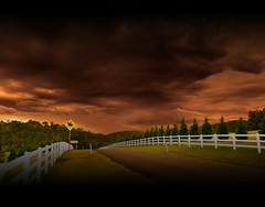 Another Rural Stormy Afternoon (rhyspope) Tags: road street sunset orange cloud white mountain storm black grass weather sign yellow contrast rural sunrise canon fence landscape countryside track afternoon ominous country hill border australia trail thunderstorm aussie tar caminho 500d bituman mygearandmepremium cloudsstormssunsetssunrises rhyspope