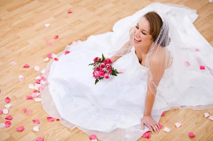 bride on floor with rose petals