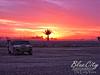 Iraqi Sunset (Trask Smith) Tags: 2005 sunset camp sky orange clouds iraq palmtree baghdad f2 humvee contractor base usarmy kbr operationiraqifreedom campliberty victorynorth northvictory