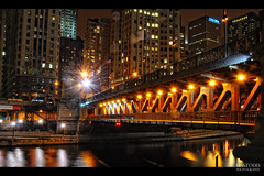 Michigan Ave Bridge Lights (C. Dastodd) Tags: christmas longexposure travel bridge winter holiday chicago cold tourism architecture night river lights illinois downtown boulevard north january drawbridge chilly michiganavenue chicagoriver avenue gapersblock magnificentmile chicagotribune magmile chicagoist chicagoreader 2011 movablebridge timeoutchicago