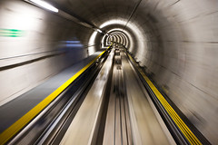 Tunnel Vision (Popeyee) Tags: world pictures city travel motion blur speed train canon photography switzerland photo airport movement flickr gallery foto photographer image photos pics zurich picture cities tunnel images terminal vision fotos shuttle 5d arrival zrich flughafen bild departure effect departures popeye bilder arrivals tunnelvision markii kloten zri abflug 2011 ankunft canon1635mm 5dmkii popeyee popeyeeflickr