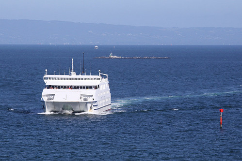 MV Queenscliff crosses the bay, Pope's Eye and Chinaman's Hat in the background