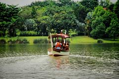 Putrajaya Lake (Tareq Abuhajjaj | Photography & Design) Tags: show light sky bw moon green grass dark photography lights boat photo nikon flickr alone top side gray arabia  2010   tareq     d700    tareqdesigncom tareqmoon tareqdesign   abuhajjaj    tareqtareqabuhajjajabuhajjaj0504233328