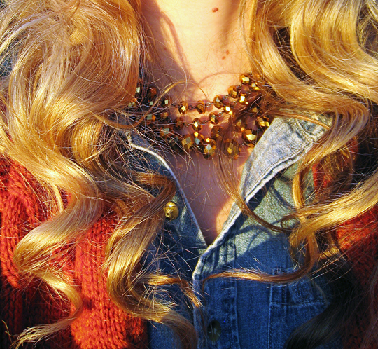 gold beaded necklace+curled hair+denim shirt