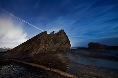 elephant rock (Pawel Papis Photography) Tags: ocean city sky cloud elephant beach water rock night plane star coast long exposure rail