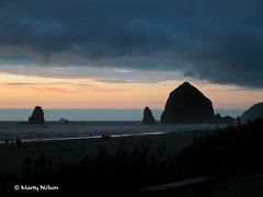 Indigo Magic - Sunset at Cannon Beach, Oregon -- August 2010.  Copyright by Marty Nelson. (Marty Nelson Photography) Tags: ocean travel sunset sky usa west beach nature water oregon america landscape outdoors scenery rocks waves pacific cloudy unitedstatesofamerica silhouettes sunsets stormy adventure beaches oregoncoast cannonbeach haystackrock vacations pacificcoast nightfall pinkclouds westernusa blueclouds perfectsunsetssunrisesandskys awardwinningphotograph naturessilhouette viewsofamerica westernamerica indigoclouds photographyforrecreationgoldaward photographyforrecreationemeraldaward photographyforrecreationsilveraward photographyforrecreationbronzeaward indigomagic midnightblueclouds americanvacations
