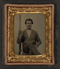 [Unidentified soldier in Confederate battleshirt with musket] (LOC) (The Library of Congress) Tags: soldier rebel gun confederate civilwar libraryofcongress thesouth confederacy rebels csa musket americancivilwar warbetweenthestates uscivilwar confederatestatesofamerica battleshirt thecivilwar xmlns:dc=httppurlorgdcelements11 theconfederacy dc:identifier=httphdllocgovlocpnpppmsca27188